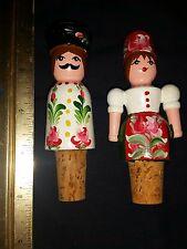 Two hand painted man and woman wood wine cork stoppers
