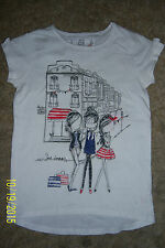 GIRLS WHITE T.SHIRT WITH PRINT ON THE FRONT AGE 9 YEARS