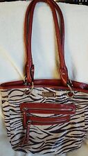 Rosetti zebra stripe fabric shoulder bag with red faux leather trim and straps