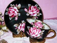 OCCUPIED JAPAN BOLD PINK ROSES IRIDESCENT BLACK 4 FOOTED TEA CUP AND SAUCER