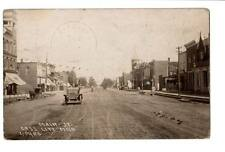 1916 RPPC real photo Main St.Cass City,Mi store fronts advertising cars buggys #