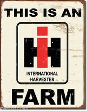 This is an IH Farm TIN SIGN rustic metal poster tractor garage barn decor 1279