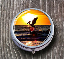 FLYING PELICAN OVER SEA AT SUNSET BEACH PILL BOX ROUND METAL -trc2Z