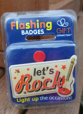 flashing pin badge/ fridge magnet new in original pack. 'LET'S ROCK'