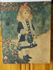 "Reproduction of Renoir's painting ""A Girl With A Watering Can"" framed."