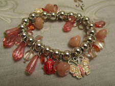 Silver Tone & Pink Plastic Bead Elasticated Bracelet with Ladybird Charms