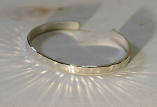 Sterling silver hammered cuff bracelet with shining radiance