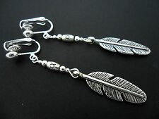 A PAIR OF  TIBETAN SILVER DROP DANGLY  FEATHER THEMED CLIP ON EARRINGS. NEW.