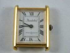 VINTAGE THUNDERBIRD LADIES WATCH GOLD TONE WITH BLUE  COLORED STONE IN CROWN