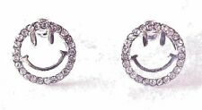 SILVER CUTOUT HAPPY FACE STUD EARRINGS WITH CRYSTAL RHINESTONES. EMOJI