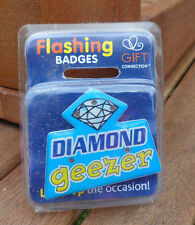 flashing pin badge/ fridge magnet new in original pack. 'DIAMOND GEEZER'
