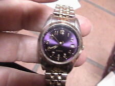 purple and two-tone wrist watch with second hand works tx5406