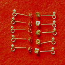 10 pairs gold plated earstuds with loop, incl scrolls, findings for jewellery