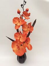 Silk/Artificial Flower Arrangement In Vase: Orange Orchid/Black Vase