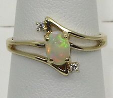 Estate 14k y.gold ring with 4x6mm Opal and Diamond, t.weight 2.10 gram,size 5.5