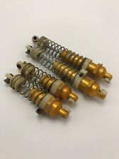 Vintage Team Associated Rc10 front and rear gold shocks