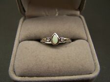 10k white gold Opal & diamond ring size 6.75 pear shaped Opal round dia. accents