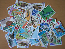 25 DIFFERENT PREHISTORIC CREATURES ON STAMPS.