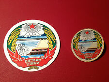 NORTH KOREAN EMBLEM:    GOLD PLATED BADGE  &  PHONE STICKER