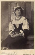 YOUNG WOMAN WITH NECKLACE IN CASUAL DRESS AND CORSET