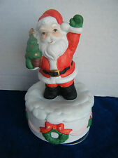 Musical Ceramic Santa Claus holding tree, rotates on base when wound up!