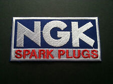MOTOR RACING RALLY NASCAR SEW / IRON ON PATCH:- N.G.K. SPARK PLUGS (a) BLUE