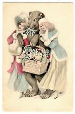 POSTCARD WOMEN WITH BEAR CARRYING NEW YEAR'S GOOD LUCK CHARMS