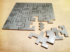 Laser cut stainless steel puzzle