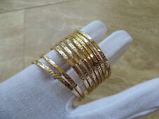 14k Gold Child Petite Slip On Bangle Bracelet set of 9 bracelets.