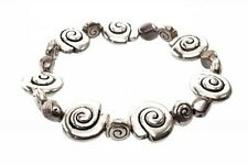 Silver Tone Swirly Shell Shaped Metal Bead Elastcated Stretch Bracelet