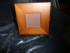 VINTAGE PICTURE FRAME 3X3 SIZE PIC IN A WOOD FRAME ON A BLACK METAL STAND