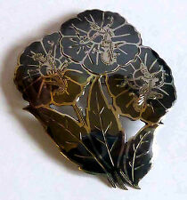 A VINTAGE 1940s SIAM STERLING SILVER & BLACK NIELLO WORK FLOWER SHAPED BROOCH