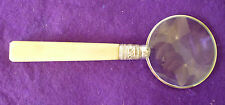 AN ANTIQUE MAGNIFYING GLASS – WITH ORNATE GRIP