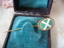 Antique vintage old hat pin with white diagonal cross on green flag hatpin