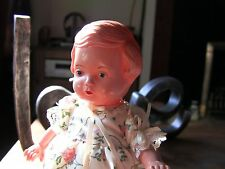 "Lovely Vintage Edi doll. Little girl in a floral dress. Approx 6 1/2"" tall"