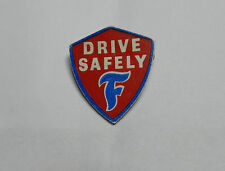 1960's Firestone tyres Drive Safely fitters badge Plastic