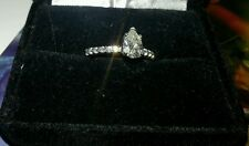 Pear shaped .66 ct si1 clarity h/i diamond ring platinum band engagement