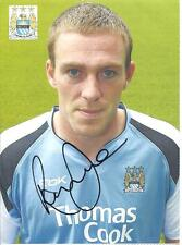 A 6.5 x 4.75 inch postcard featuring signed by Richard Dunne at Manchester City