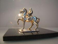 ~ Silver miniature figure of Lady Godiva nude on horseback, on black marble.