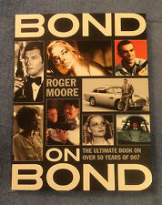 Hand Signed NEW revised paperback BOOK - BOND ON BOND by SIR ROGER MOORE - 007