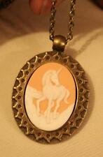 Lovely Etched Brasstone Starburst Peach White Prancing Unicorn Medal Necklace