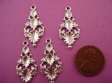 6 silver ox triple pod floral charms with open cut 27mm