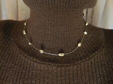"A Stylish 16.5"" Monet Gold-tone Metal Bead Choker Necklace Strung on Wire."