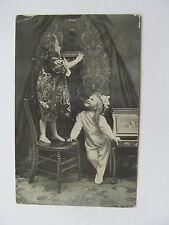 1910 German postcard, Young girl with telephone, stood on chair, another looking