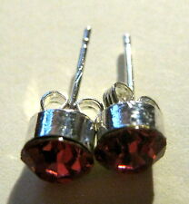 Earrings Silver tone metal studs with pink/red shaded stones