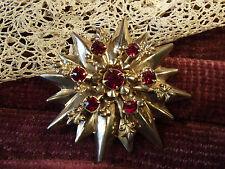 Spilla vintage stella tono oro  inserti swarovski rossi  U.S.A.