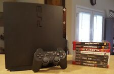Sony PlayStation 3 Slim with new 500GB hard drive, controller, and games