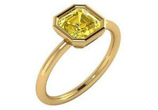1.28 ct GIA fancy intense yellow SI2 square radiant diamond bezel solitaire ring