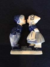 Hand painted in Delft Blue Kissing boy and girl figures