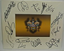10 x 8 inch mount personally signed by 13 of the Blackpool 2014-15 squad